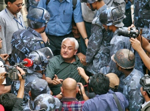 Kanak Dixit being arrested, April 2006, Kathmandu