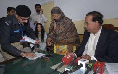 Punjab Governor Salmaan Taseer with 'blasphemy' accused Aasia Bibi: he paid for his stand with his life