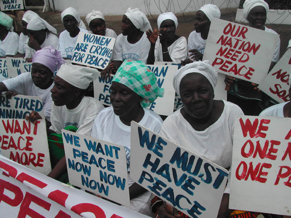 Liberian women demonstrate at the American Embassy in Monrovia at the height ...