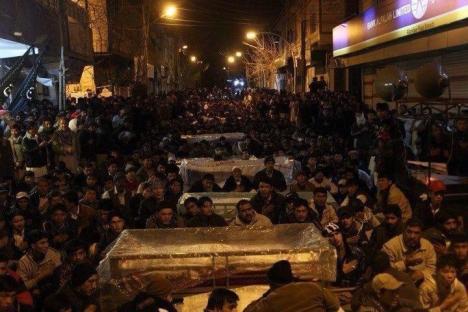 Alamdar Road, Quetta: Shia Hazara protestors sitting with coffins in the freezing cold.
