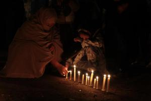 Grieving women light candles at the ongoing dharna in Quetta