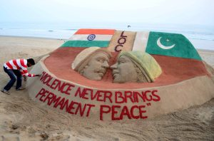 "Sand artist Sudarsan Pattnaik creates a sand sculpture influenced by skirmishes along the India-Pakistan border with a message ""Violence never brings permanent peace"". AFP photo"