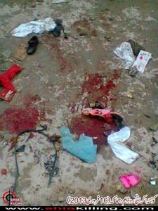 After the blast: Children's shoes and a doll on the blood-splattered road at Kirani Road, Quetta