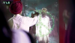 Tracing a peace sign together via a giant web-cam