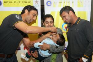 'Bowl out polio': Pakistani cricketers Younis Khan and Imran Farhat give polio drops to a child at a UNICEF event in New Delhi, Jan 2013. Photo: PTI