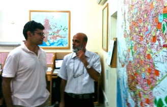 Engaged and committed: Aman Foundation CEO Ahsan Jamil and Manager Command and Control Center in discussion.