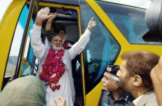 April 7, 2005: Pakistani passengers wave as they board the first bus heading to Srinagar from Muzaffarabad, the first bus service to link divided Kashmir in nearly 60 years. Photo: Jewel Samad/AFP/Getty Images