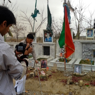 At the Hazara graveyard in Quetta: Agha Mujtaba practices walking, Anas filming him