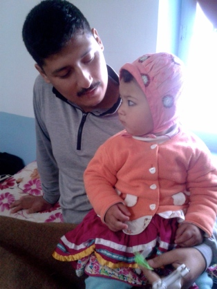 Back in Quetta: Agha Mujtaba with his baby daughter