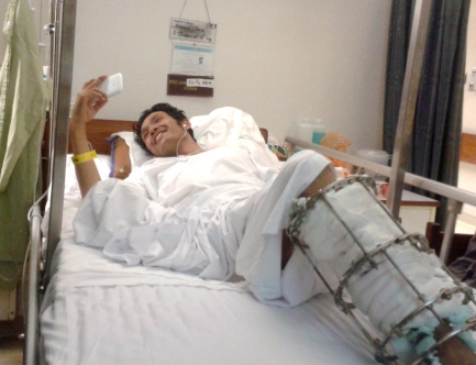 Skyping with his family in Quetta, amputee Zakir Hussain flashes a cheerful smile from his hospital bed in Karachi.