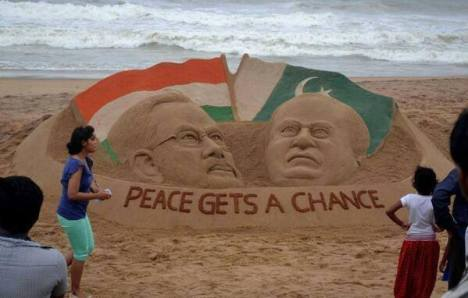 "May 25, , Puri beach, Odisha: Sand artist Sudarshan Pattnaik's image of India's Prime Minister-designate Narendra Modi and the Pakistan Prime Minister Nawaz Sharif made in sand, with the message "" Peace gets a chance'."