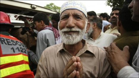 Elderly man grieves after the May 2010 attack on the Ahmadi mosque in Lahore. File photo