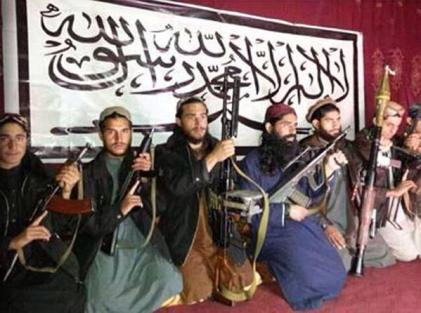 """Not Muslim? Attackers of APS Peshawar photographed prior to their mission, in front of a banner inscribed with the first Kalima of Islam: """"There is no god but Allah and Mohammad is His Prophet""""."""
