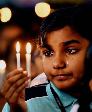 A student in Chennai prays for those killed in Peshawar. Schools across India held a two-minute silence on Wednesday. Photo: R. Senthil Kumar/ PTI