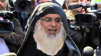 Islamabad, 2007: Abdul Aziz surrounded by media after his arrest.