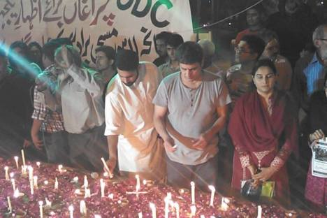Karachi, March 15: Civil society members in solidarity with Pakistan's Christian community; at Numaish,  Jibran Nasir and Shaan Taseer light candles. Photo: Rehan Mazhar