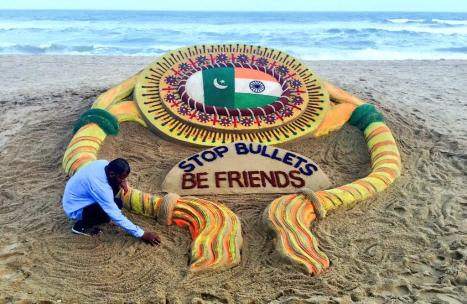 "Sand artist Sudarsan Pattnaik's piece for Raksha Bandhan at Puri beach, Odisha, with a message urging India and Pakistan to ""Stop Bullets, Be Friends"""