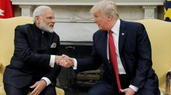 U.S. President Trump shakes hands with India's Prime Minister Modi in the Oval Office the White House in Washington